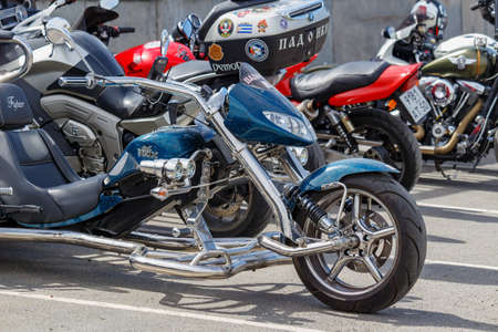 Moscow, Russia - May 04, 2019: Chromed BOOM tourist trike in a parking at sunny day. Moto festival MosMotoFest 2019