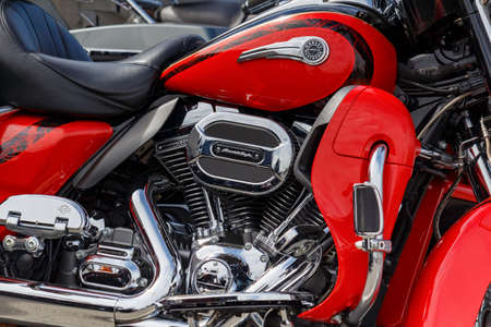 Moscow, Russia - May 04, 2019: Fragment of chrome engine with exhaust system pipes of Harley Davidson motorcycle. Moto festival MosMotoFest 2019