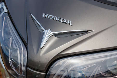 Moscow, Russia - May 04, 2019: Headlights in silver colored windproof shield of Honda motorcycle closeup. Moto festival MosMotoFest 2019