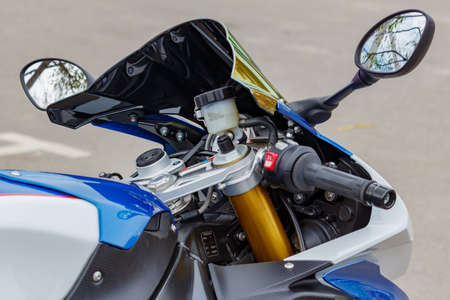 Moscow, Russia - May 04, 2019: Handlebar with windproof shield and rearview mirrors of BMW sports motorcycle closeup. Moto festival MosMotoFest 2019 Editorial