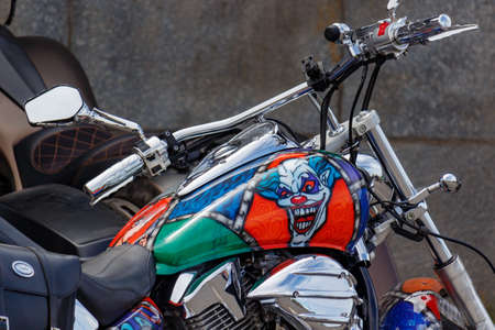 Moscow, Russia - May 04, 2019: Honda tourist motorcycle with airbrushing of evil clown on fuel tank closeup. Moto festival MosMotoFest 2019