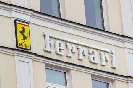 Moscow, Russia - June 02, 2019: Ferrari signboard on the building wall above entrance to the official dealer showroom