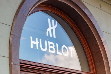 Moscow, Russia - June 02, 2019: Glass showcase with Hublot signboard in the center of Moscow at sunny day
