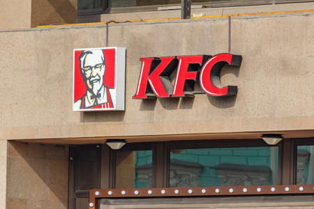 Moscow, Russia - September 13, 2019: KFC sign on the building wall. Kentucky Fried Chicken is international chain of catering restaurants