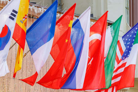 Flags of different countries close-up in sunlight Stock fotó