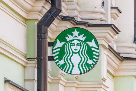 Moscow, Russia - September 13, 2019: Starbucks round sign with image of the two-tailed mermaid Siren on a green background. Contemporary Starbucks sign Editorial