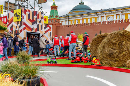 Moscow, Russia - October 05, 2019: Stewards prepare for the start of the participants of the children attraction Racing on traditional festival Golden Autumn in Moscow on Red Square