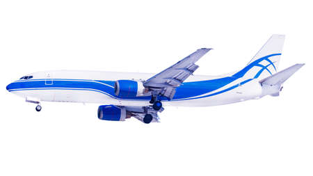 Flying modern cargo aircraft with landing gear isolated on a white background. Side view