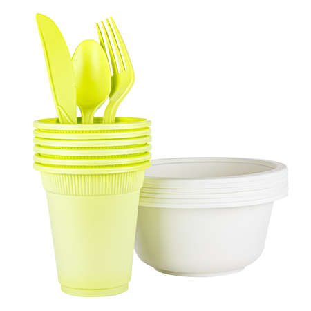 Set of six unused green disposable cups with knife, spoon, fork and white bowl made of biodegradable materials isolated on white background