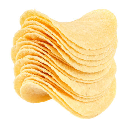 Yellow slices of potato chips with sour cream and onions isolated on white background close-up Stock Photo