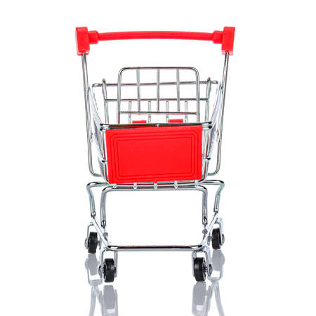 Front view of empty chromed toy market shopping cart with red handle and plastic board. White background with reflection on the glossy glass surface