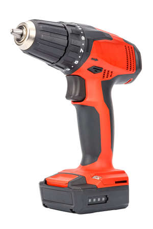 Cordless 12V drill driver powered by Li-ion battery with keyless chuck in red and black rubberized reinforced plastic case isolated on white background. Cut out construction tool image