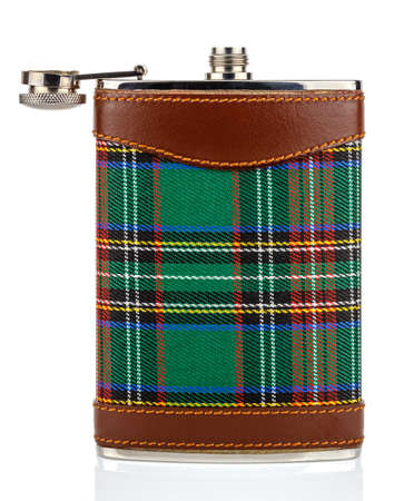 Classical scotland pewter hip flask with leather and tartan trim isolated on white background