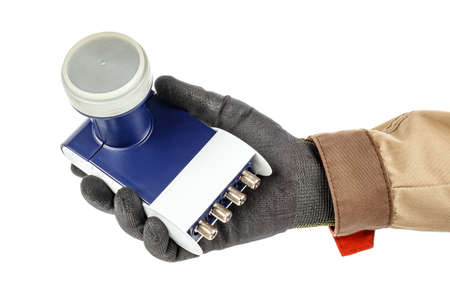 Satellite dish LNB in man hand in black protective glove and brown uniform isolated on white background