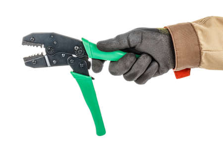 Electrician hand in black protective glove and brown uniform holding crimping tool for mounting BNC connectors isolated on white background Stock Photo