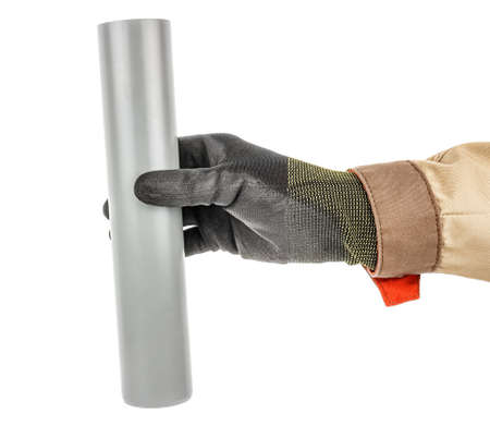 Plumber hand in black protective glove and brown uniform holding grey plastic sewer pipe isolated on white background Banque d'images