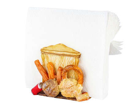 Old colored ceramic holder with white paper napkins isolated on white background Standard-Bild