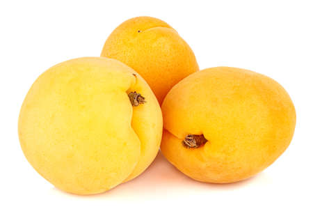 Three fresh and ripe apricots isolated on white background Standard-Bild