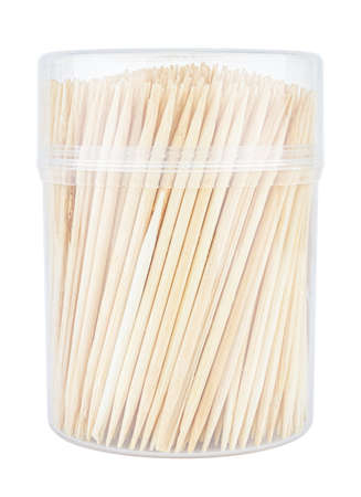 Wooden toothpicks in closed transparent plastic cylindric box isolated on white background