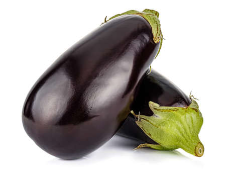 Two uncooked fresh aubergines isolated on white background