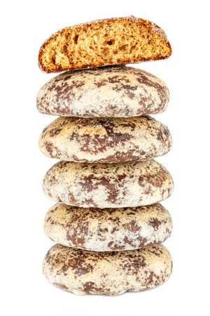 Five whole and one broken on top gingerbread cookies in stack isolated on a white background Archivio Fotografico