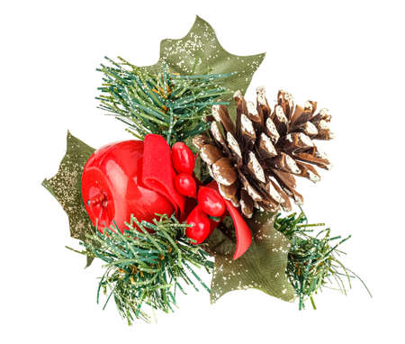 Decorative christmas wreath with pine cone and red apple close-up isolated on white background