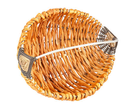 Lying on side empty handmade small wicker basket with wire handle isolated on white background