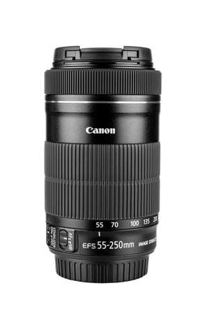 Moscow, Russia - July 18, 2020: Vertical standing on rear protective cap Canon EF-S 55-250 mm lens with autofocus and stabilizer isolated on white background