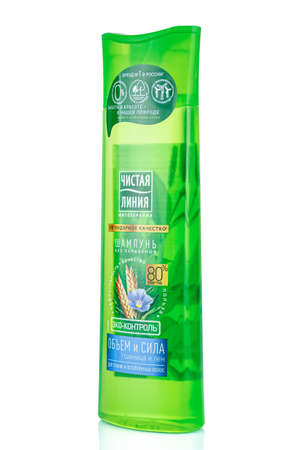 Moscow, Russia - July 22, 2020: Side view of CLEAN LINE paraben free shampoo with wheat and flax for thin and weakened hair in a green plastic bottle isolated on white background