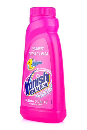 Moscow, Russia - July 22, 2020: Side view of Vanish Oxi Action liquid stain remover for fabrics without chlorine in a bright pink plastic bottle isolated on white background
