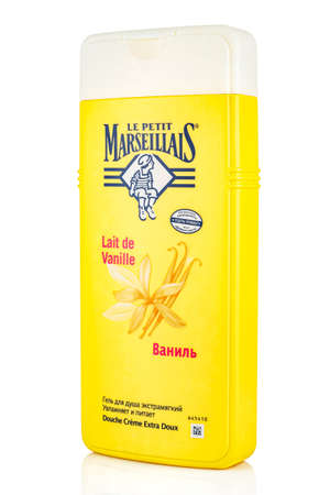 Moscow, Russia - July 22, 2020: Side view of Le Petit Marseillais vanilla shower gel extra soft in a yellow plastic bottle with white cap isolated on white background