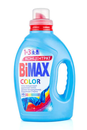 Moscow, Russia - July 22, 2020: BiMAX COLOR concentrated laundry gel in a blue plastic bottle with red dispenser isolated on white background