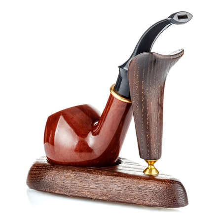 Smoking tobacco pipe on wooden bracket isolated on white background close-up. Rear view