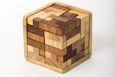 built: A cube built from wooden blocks. Puzzle.