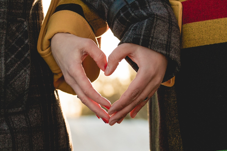 love hands: bride and groom holding hands in the shape of heart Stock Photo