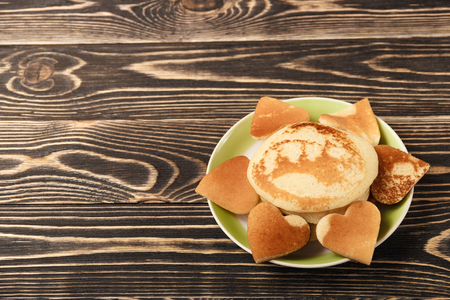 shrove tuesday: heart-shaped pancakes on wooden table, Shrove Tuesday, Valentines Day