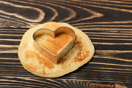 shrove: heart-shaped pancakes on wooden table, Shrove Tuesday, Valentines Day