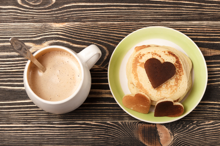 shrove: stack of pancakes with on brown wooden board, heart-shaped, Shrove Tuesday, Valentines Day Stock Photo