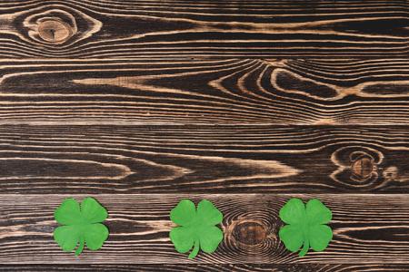 four leaf: Four leaf clovers on brown wooden background