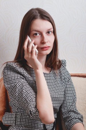 spontaneous expression: Thoughtful young woman talking on the phone. life style