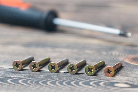 matting: screw driver on a brown wooden matting
