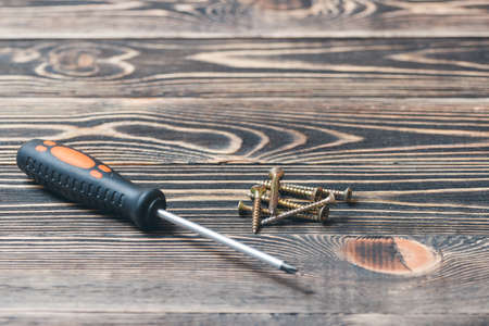 screw driver: screw driver on a brown wooden matting