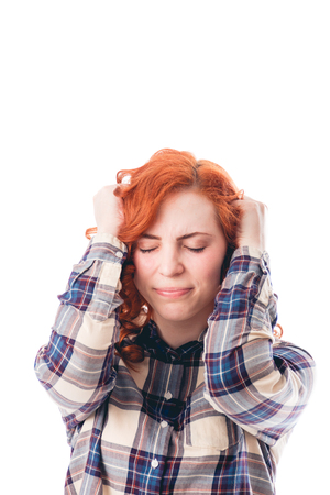splitting headache: woman with head ache holding her head. Isolated over white background