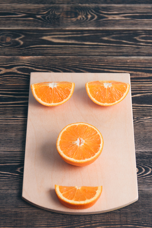 lobule: Orange, Half of Orange, Orange Lobule on the Wooden Table. Healthy Lifestyle Concept
