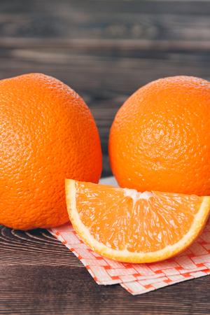 lobule: Orange, Orange Lobule on the Wooden Table. Healthy Lifestyle Concept