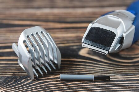trimmer: Electric Razor, Hair Trimmer on a Wooden Table, Care Concept Stock Photo