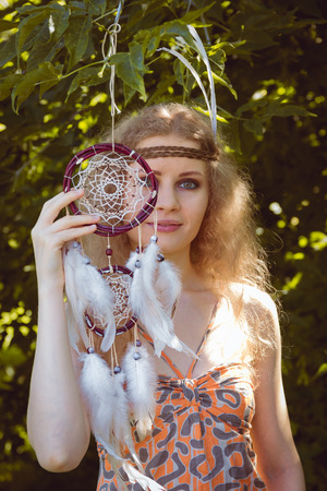 alongside: Beauty Portrait of Girl with Dreamctahcer Hanging Alongside Outdoor