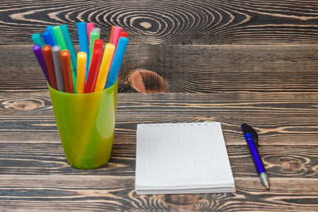 yardstick: Education Concept. School and Office Supplies on Wooden Background with Place for your Text