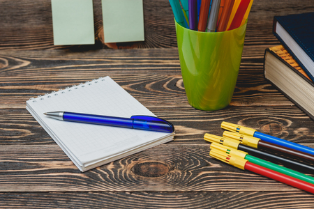 yardstick: Education Concept. School and Office Supplies on Wooden Background