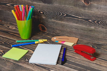 yardstick: Education Concept. School and Office Supplies on Wooden Background.